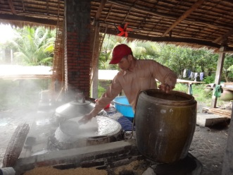 Creating the rice sheets on a hot plate