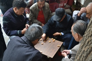 Old men playing Chinese checkers