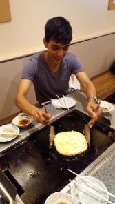 Making 'Okonomiyaki' - a Japanese omelette in Kobe prefecture, Japan.